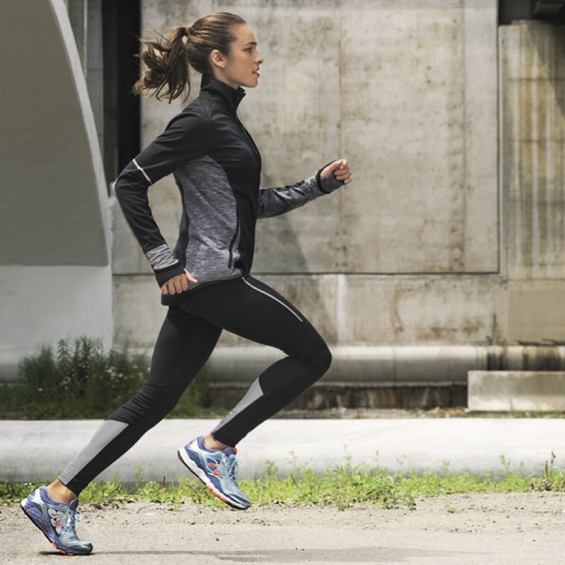 Woman running in sports apparel